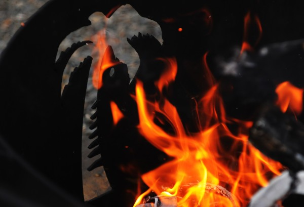 A palm tree decorates one of Fred and Monica Patterson's custom-made fire rings.