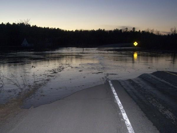 Flood water from a beaver dam flowage impoundment area that was breached about 6:30 p.m. Friday, March 23, 2012, covers a section of Route 15 in south Orrington. The water made it as far as the Pan Am Railways train tracks before it began to recede shortly after 9 p.m.