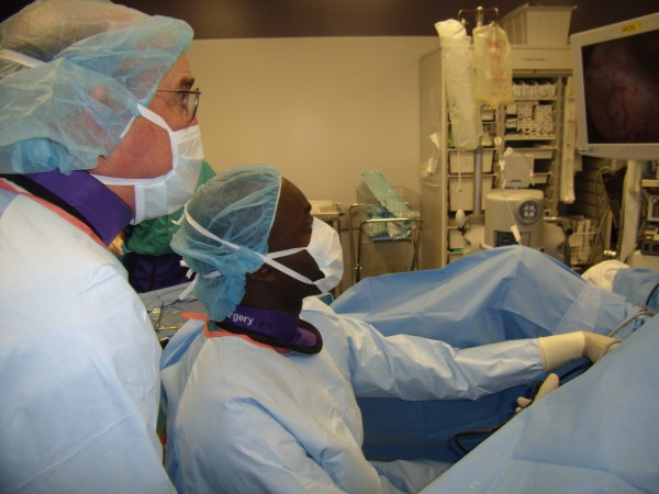 Dr. Sam Broaddus, director of Maine Medical Center's division of urology with Dr. Jory Desir (left) of Cap-Haitien, Haiti, at Maine Medical Center's Scarborough Campus operating room.