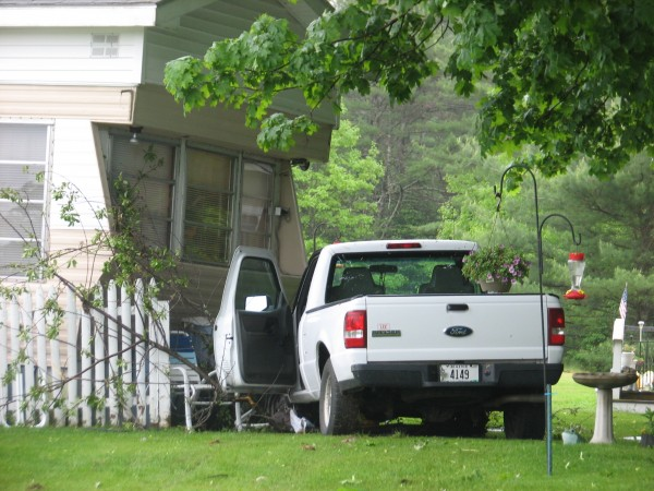 A 2006 Ford Ranger pickup truck nearly struck a mobile home on Route 1 in Hancock around 1 p.m. Tuesday, May 29, 2012. No significant injuries or damage was reported as a result of the accident. The truck did destroy several plants and small trees as it sped off the road and through a neighboring yard before coming to rest inches away from the mobile home.