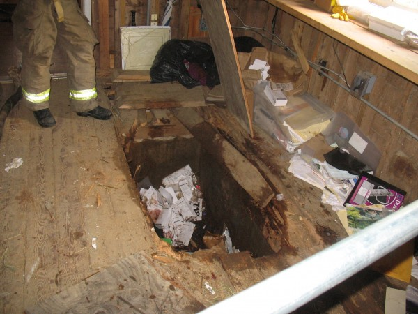 This 4- to 5-foot deep hole opened up under Duke, a carriage road horse in Acadia National Park, after he apparently got out of his stall in Wildwood Stables and went wandering in the building.