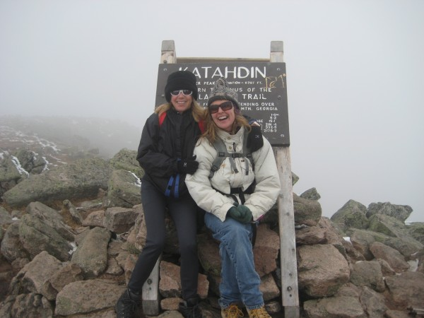 Susan Hopp (left) and Donna Davidge pose for a photo by the sign on Baxter Peak, the summit of Mount Katahdin in October 2010.