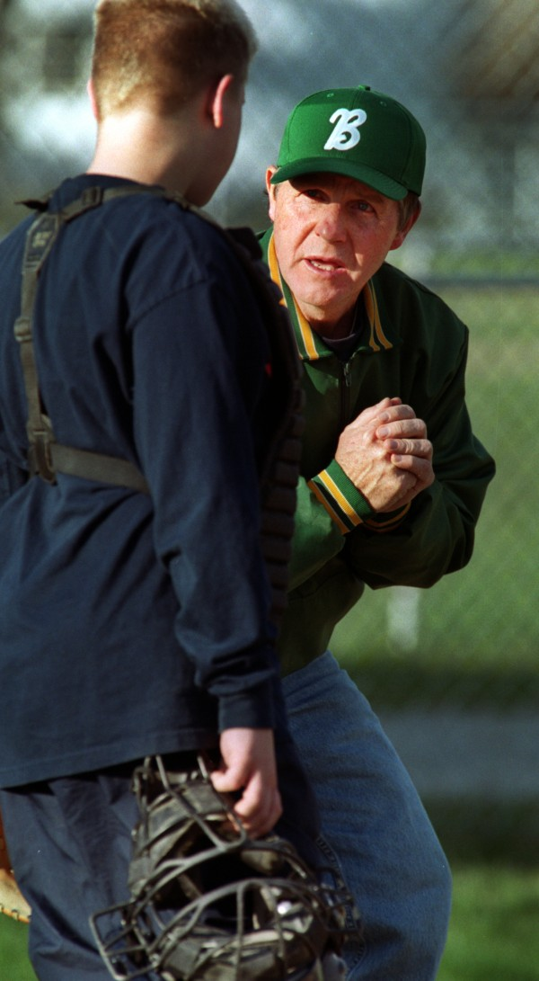 Dennis Libbey works with catcher Nick Dunn during Little League practice in Bangor in 2002. Libbey is being inducted into the Maine Sports Hall of Fame on Sunday, May 20, 2012 at the Bangor Civic Center.