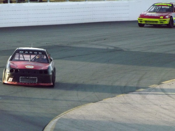Mike Mason of Skowhegan drives into turn one with Minot's Scott Farrington (22) trailing at New Hampshire Motor Speedway during a North East Mini Stock Tour race on May 12, 2012. Mason went on to win.