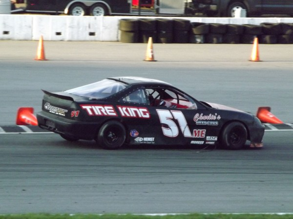 Mike Mason of Skowhegan drives into the second turn on the final lap of a North East Mini Stock Tour race at New Hampshire Motor Speedway on May 12, 2012. Mason went on to win.