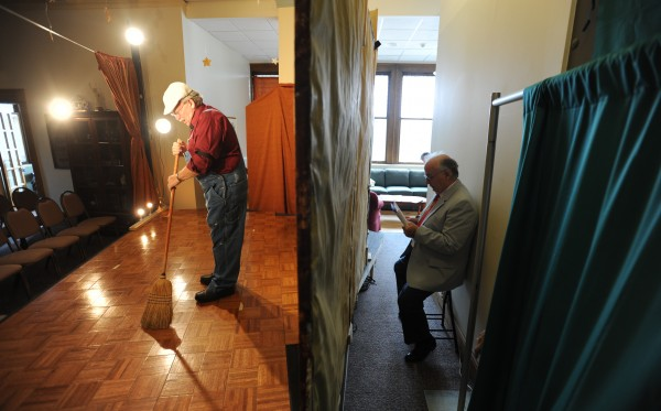 Paul Rich, playing the part of Doc Logan, sweeps the stage of the Skylight Club during dress rehearsal of the original play at the Hammond Street Senior Center in Bangor on Thursday, May 17, 2012 as Edward baker (right) sits backstage ready to prompt those actors that might forget a line.