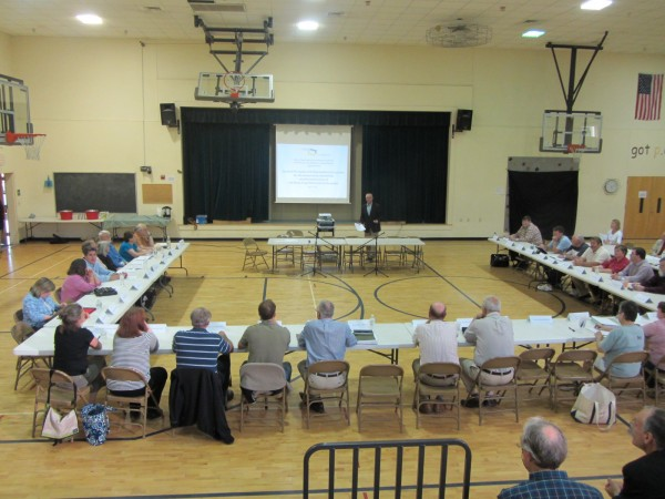 The board of directors from school districts from Waldoboro to Islesboro gathered Monday evening to hear the presentation about the Many Flags/One Campus project.