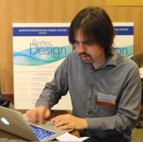 Cesar Hidalgo works at laptop on Thursday after delivering the keynote address at Trade Day 2012, an event hosted by the Maine International Trade Center.