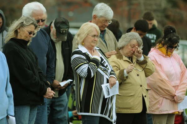 People pray as a group along the Bangor Waterfront on Thursday, May 3, 2012 as part of National Prayer Day.
