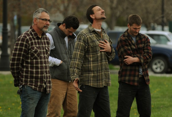 John Veilleux (from left), John Fleming, Paul Pimentel and Rosaire Veilleux express themselves in prayer as they join others along the Bangor Waterfront on Thursday, May 3, 2012 during the National Day of Prayer.