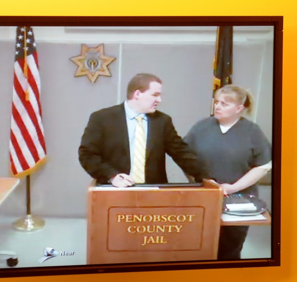 Tanya Leigh Strout (right) talks to Benjamin Fowler, attorney of the day, during her initial court appearance via video conference in April 2012.