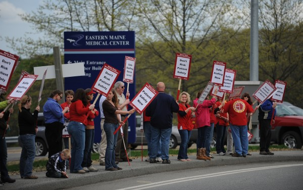 Members of the Maine State Nurses Association and their supporters rally in front of EMMC in Bangor on Tuesday, May 15, 2012, for an informational picket to allow members of the public to know about their negotiations with EMMC administrators.