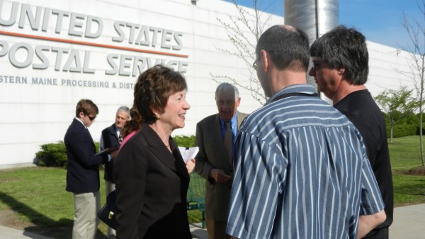 Employees of the Eastern Maine Processing and Distribution Center in Hampden discuss the future of their workplace with U.S. Sen. Susan Collins during her visit to the facility on Friday, May 18. The congresswoman dropped by the facility to greet employees and discuss her efforts to prevent the plant's closure. Earlier this week, Collins announced that the plant will not close under a new policy adopted by the postmaster general that was part of a Senate-passed postal reform bill she co-wrote.