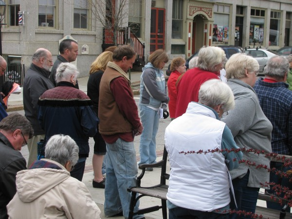 About 50 people gathered at noon Thursday, May 3, 2012 in Post Office Square in Belfast to bow their heads and take part in the National Day of Prayer.