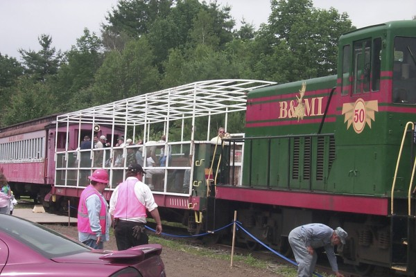 Train lovers climbed aboard the Belfast & Moosehead Lake Railway's observation car and coach for the opening weekend of excursions on the fabled short line in July 2009.