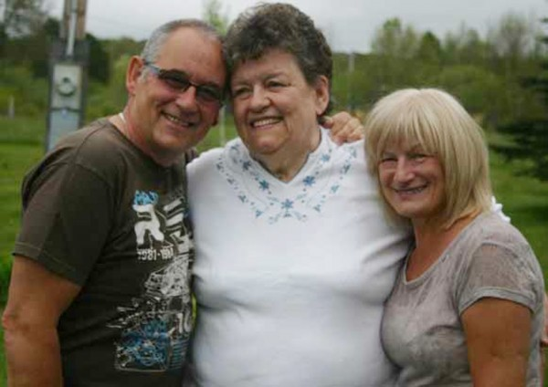 Geoff Toone, of Newhall, England, was reunited with his sister, Janet  Washington (middle) for the first time in 48 years during a visit to Parkman this month with his wife, Susan Toone. Both siblings  were mistakenly informed the other had died.
