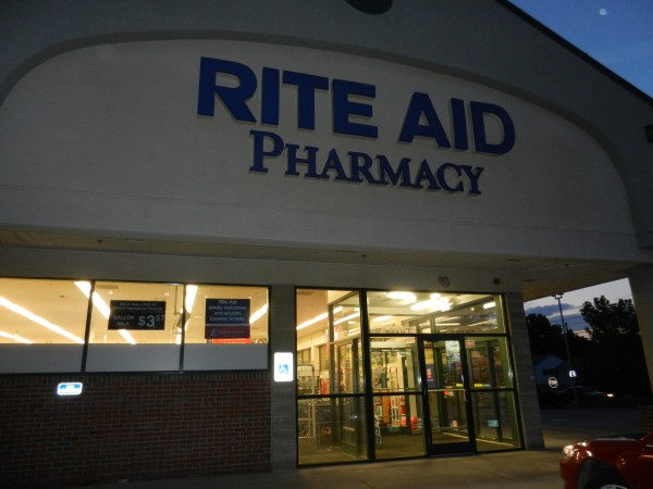 The exterior store and parking lots at the Rite Aid pharmacy on Union Street were dark before regular closing time Wednesday night an hour after the store had been robbed a second time in nine days. Two suspects were apprehended by police about an hour after the robbery.