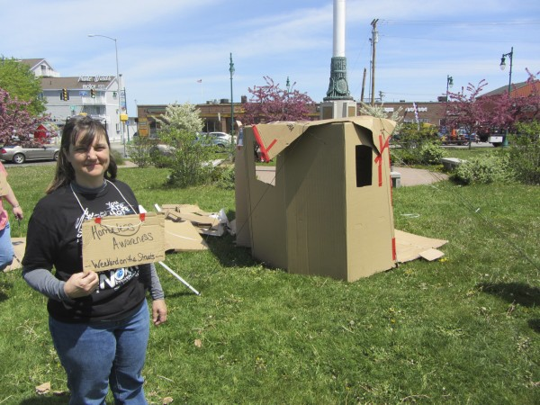 Melissa Harvill discusses the effort to educate the public about the plight of the homeless in the Rockland area while standing next to the fledgling cardboard village being erected at Chapman Park in downtown Rockland.