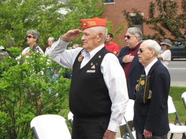 Rockland World War II veteran Leroy Peasley (left) and Rockland Korean War veteran Doug Curtis Sr. salute during Memorial Day ceremonies held in Rockland on Monday, May 28, 2012.