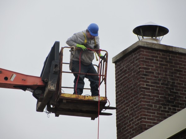 Jeff Darling is one of the workers performing masonry repairs to the Rockland Community Center on Tuesday, May 8, 2012.