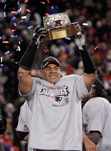 In this Jan. 20, 2008, file photo, New England Patriots linebacker Junior Seau holds the Lamar Hunt Trophy looks on after defeating the San Diego Chargers 21-12 in the AFC Championship NFL football game in Foxborough, Mass. Police say Seau, a former NFL star, was found dead at his home in Oceanside, Calif., Wednesday, May 2, 2012, after responding to a shooting there.