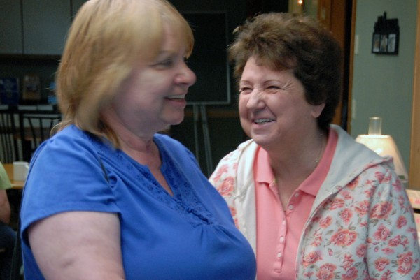 Pauline Whitney (right) of Chester and Chrystle Shields of Lincoln share a joke at the Golden Key Senior Center on Wednesday, May 23, 2012.
