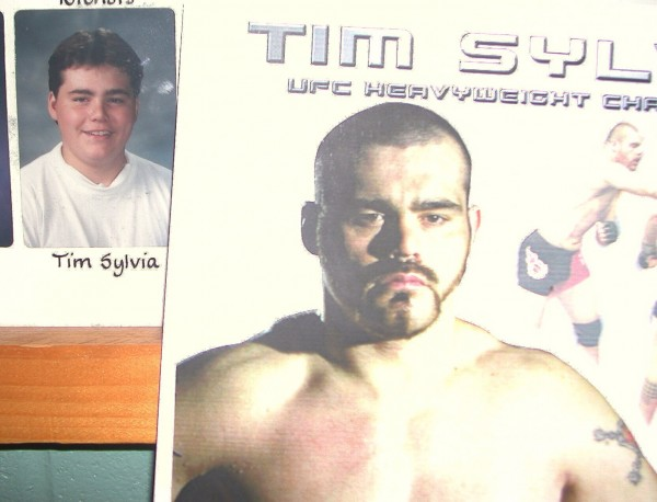 A promotional poster of Ultimate Fighting heavyweight champion Tim Sylvia (right), shows a different version of the 1992 Ellsworth High School graduate (left) compared to his senior year photograph on display in a school hallway when Sylvia visited in 2003. The Eastbrook native will fight an MMA bout in his home state for the first time June 16 in Lewiston.