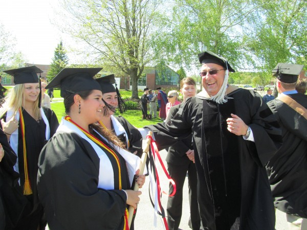 Gov. Paul LePage congratulates Thomas College graduates on Saturday, May 12, 2012 in Waterville. LePage was the ceremony's commencement speaker and recipient of an honorary doctorate in science and business administration.