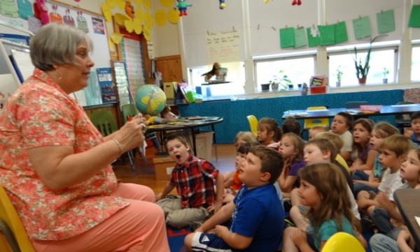 Bonnie Maguire, a reading teacher at the Gladys Weymouth School in Morrill, helps kindergarten children think of what they can write in their notes to Capt. Tyler Streit who is serving in the U.S. Air Force in Afghanistan. Streit attended kindergarten in the Morrill School nearly 20 years ago.
