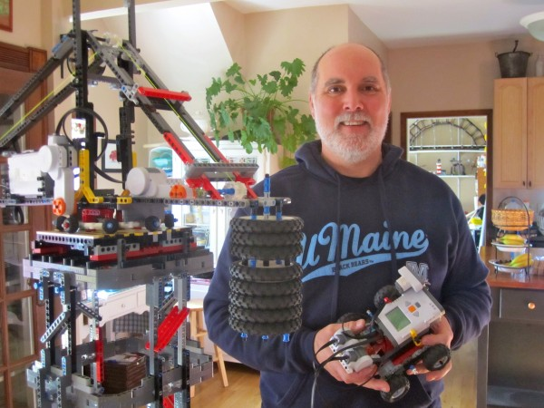 Tom Bickford, Director of Maine Robotics, at home with various LEGO creations.