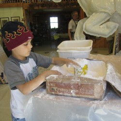 Hampden Academy students help artist build bronze bronco statue for new school