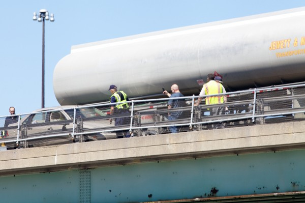 A safety crew extricates a car from a tractor-trailer on an overpass spanning Congress Street in the northbound lane of I-295 Thursday morning, June 14, 2012.
