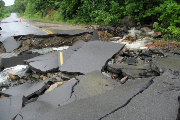 Several roads in Brownville, including Church Street, were closed and power was cut off after heavy rainfall overnight Saturday, June 23, 2012 that caused flash flooding in parts of the town.
