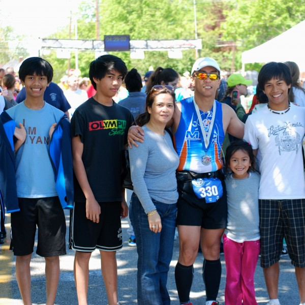 Dr. Aquilino Alamo, a Boothbay Harbor-based doctor shown here with his family after a recent road race, will cover the land side of the first-ever &quotJammers and Joggers&quot, a more than 40-mile land-and-sea race down the Maine coast. The race begins at 7 a.m. on Monday, June 25 as part of the kick-off of the 50th annual Windjammer Days Festival in Boothbay Harbor. Shown from left are twins Kyle and Karl, 15, Alamo's wife Charito; their 6-year-old daughter Ariel and 16-year-old son Jude.