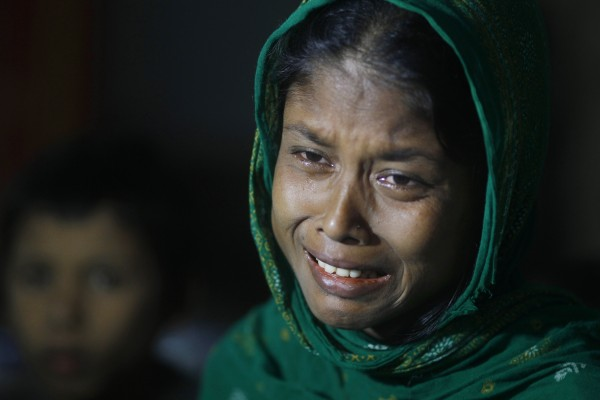 A Rohingya Muslim woman whose husband was allegedly killed in Myanmar, cries as she waits with others to be sent back to Myanmar at a camp of Border Guards of Bangladesh or BGB, in Taknaf, Bangladesh on Friday, June 22, 2012. Bangladesh turned back more than 2,000 Rohingyas who tried to enter the country after the deadly violence between Rohingyas and ethnic Rakhine Buddhists erupted this month.