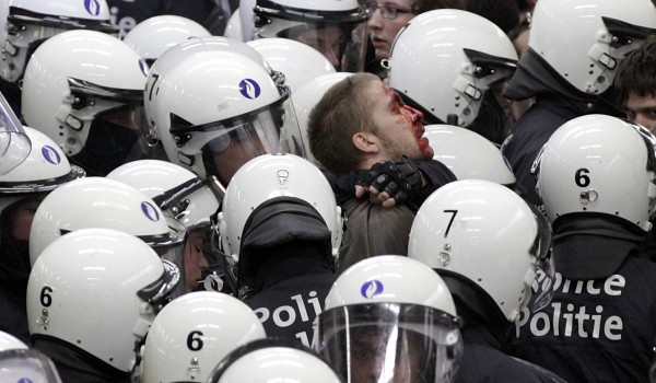 A protestor is arrested by police at an underground station during a demonstration in Brussels, Sunday, June 17, 2012. Police arrested more than a dozen demonstrators on Sunday after they disrupted a peaceful demonstration on fundamentalism and extremism.