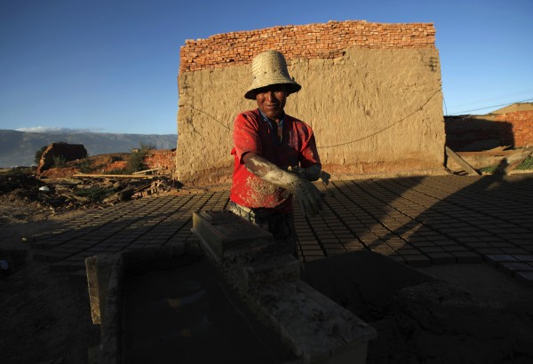 A brick maker works to make handmade bricks in Cochabamba, Bolivia, Tuesday, June 5, 2012. Brick makers charge $15 U.S. dollars for 1,000 bricks, and in one week are able to make 6,000 bricks, according to workers.