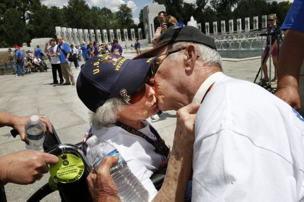WWII Navy veteran Josephine Bussard (left), 89, and her husband, WWII Marine Corps veteran Murray Bussard, 88, of Springfield, Mo., who will have been married 67 years this Friday and met during the war, kiss during a visit to the World War II Memorial in Washington, Wednesday, June 6, 2012, on the 68th anniversary of D-Day.