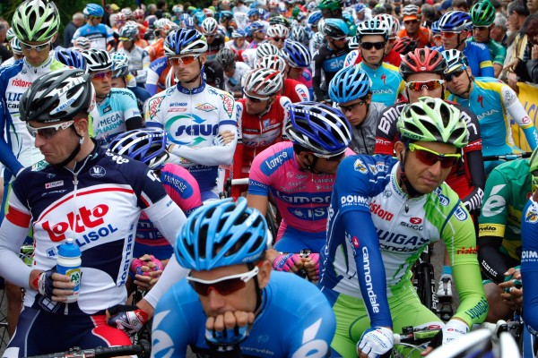 Riders await the start of the fifth stage of the 64th Dauphine cycling race, at Saint-Trivier-sur-Moignans-Rumilly, central France, Friday, June 8, 2012.