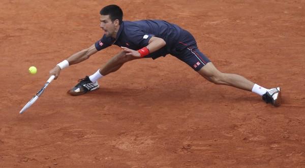 Novak Djokovic of Serbia returns in the men's final match against Rafael Nadal of Spain at the French Open tennis tournament in Roland Garros stadium in Paris, Sunday, June 10, 2012.