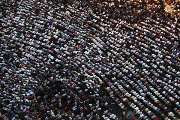 Egyptians pray during a demonstration in Tahrir Square, Cairo, Egypt on Friday, June 22, 2012. Tens of thousands of Egyptians have converged on Tahrir Square in Cairo to protest against the ruling military council's power grab and in support of the Islamist presidential candidate who they believe won the election.