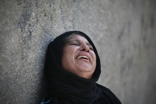 A Palestinian woman cries during the funeral of Naim al-Najar in the West Bank village of Idhna, near Hebron, Sunday, June 17, 2012. An Israeli tow truck driver shot dead two Palestinians and wounded one Sunday during what Israeli police said was an attempted car robbery in the West Bank. The incident occurred near the city of Hebron. Palestinian President Mahmoud Abbas said the shooting was the work of a Jewish settler. Those (settlers) commit their crimes under the protection of the government and Israeli military, Abbas said.