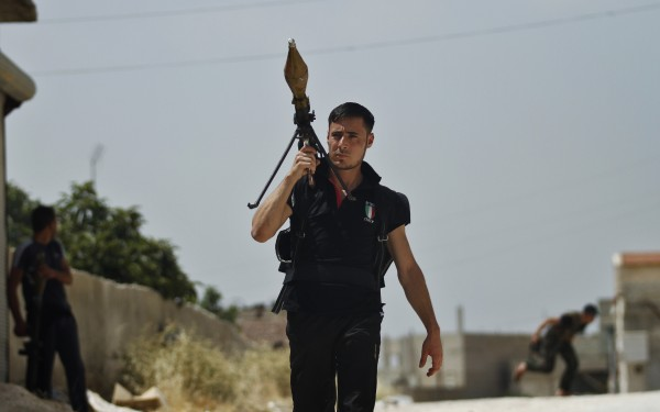 A Free Syrian Army fighter holds a rocket launcher during clashes with Syrian troops near Idlib, Syria on Friday, June 15, 2012.