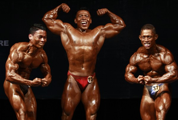 Local contestants take part in a bodybuilding contest at Myanmar Convention Center (MCC) in Yangon, Myanmar on Saturday, June 23, 2012.