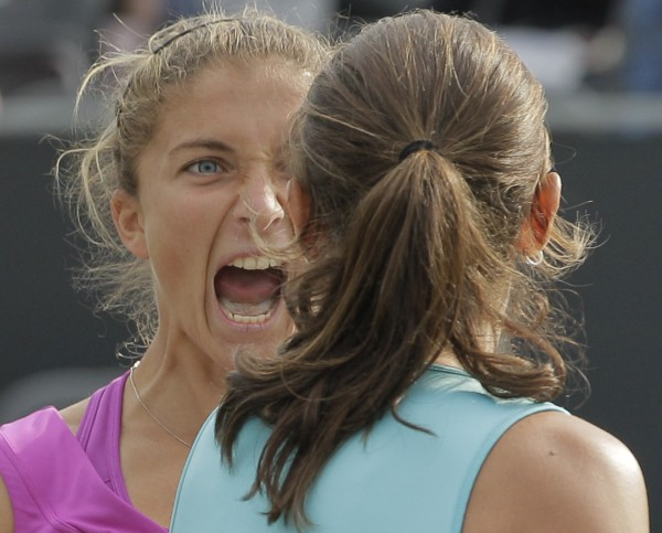 Sara Errani (left) and Roberta Vinci of Italy scream after winning the women's doubles final match against Maria Kirilenko and Nadia Petrova of Russia at the Unicef Open grass court tennis tournament in Rosmalen, central Netherlands, Saturday, June 23, 2012. Errani and Vinci won in two sets 6-4, 3-6, (11-9).