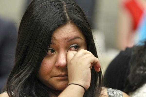 Myrna Orozco, 22, of Kansas City, Mo., an illegal immigrant originally from Mexico, wipes away tears while watching President Obama announce that the U.S. government will stop deporting and begin granting work permits to younger illegal immigrants who came to the U.S. as children and have since led law-abiding lives on Friday, June 15, 2102, in Washington.