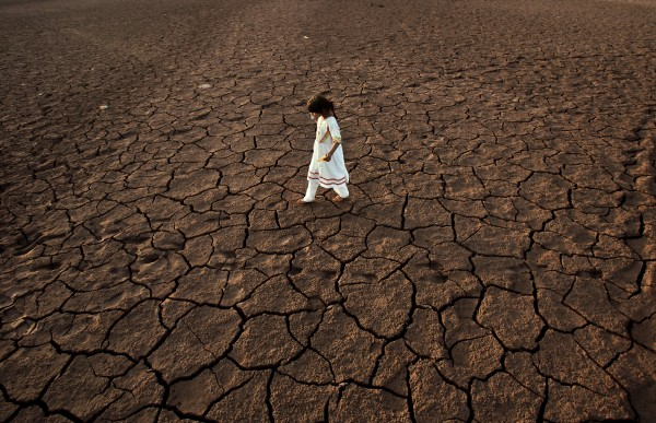 A Pakistani girl walks on a parched portion of the Rawal Lake on the outskirts of Islamabad, Pakistan on Sunday, June 17, 2012.