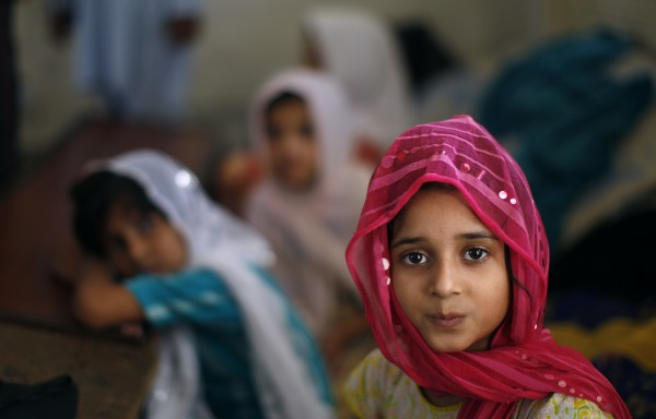 A Pakistani girl attends her daily madrassa, or Islamic school, in a mosque in Islamabad, Pakistan on Wednesday, June 27, 2012.