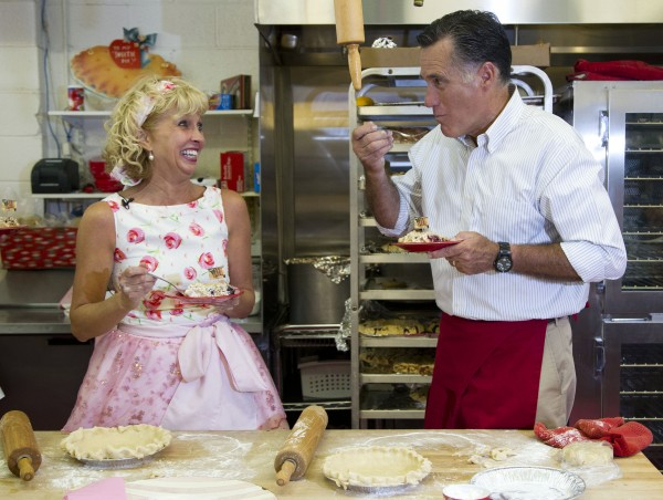 Linda Hundt, owner of Sweetie-licious Bakery (left), laughs as Republican presidential candidate, former Massachusetts Gov. Mitt Romney takes a bite of cherry pie during a campaign stop at Sweetie-licious Bakery on Tuesday, June 19, 2012 in DeWitt, Mich.