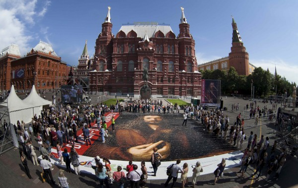 People put together a  jigwaw puzzle of a self portrait of Albrecht Duerer in front of the state historical museum in Manezh Square outside the Kremlin in Moscow, Wednesday, June 20, 2012. The 300 square meter puzzle will be set up on the occasion of the &quotGerman Year&quot in Russia.